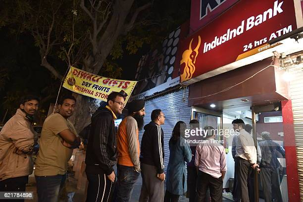 People queue up outside ATMs to withdraw hundred rupee notes at Bengali market on November 8 2016 in New Delhi India Prime Minister Narendra Modi in...