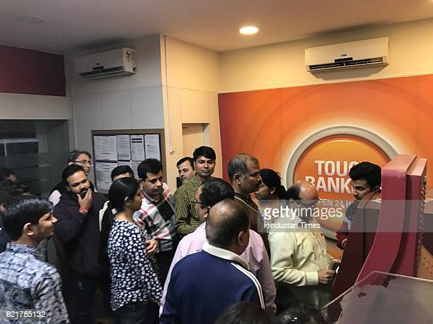 People queue up outside ATMs to withdraw hundred rupee notes at Lakshmi Nagar on November 8 2016 in New Delhi India Prime Minister Narendra Modi in...