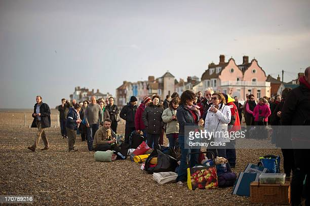 People queue up to be seated before the first performance of 'Grimes on the Beach' a production of Benjamin Britten's opera Peter Grimes at the...