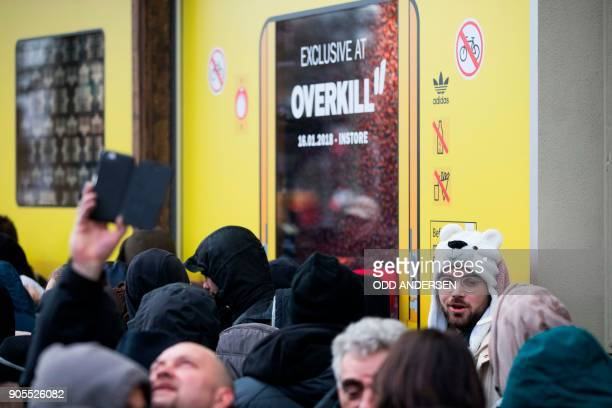 People queue up to buy the Adidas / BVG trainers outside the Overkill shoe store in Berlin on January 16 2018 The shoes set to cost 180 euro and only...