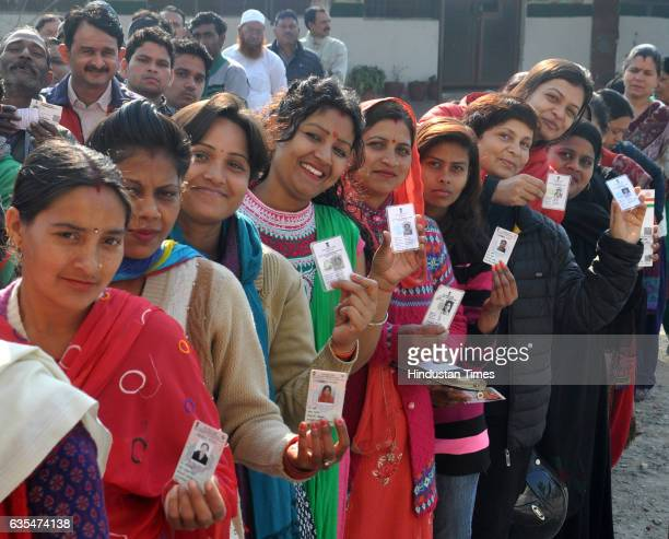 People queue up to cast their vote at a polling station on February 15, 2017 in Dehradun, India. Over 68 per cent of the electorate in Uttarakhand...