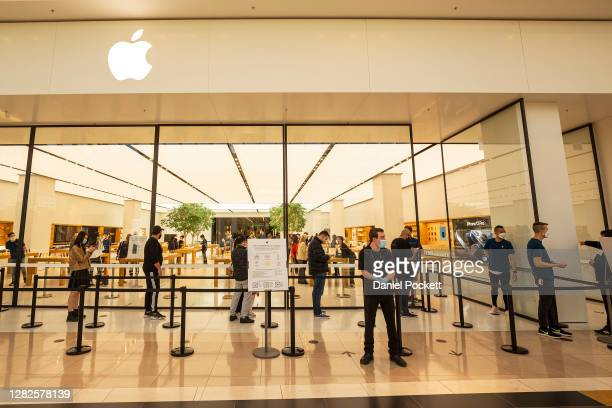 People queue up to enter the Apple store at Chadstone Shopping Centre on October 28, 2020 in Melbourne, Australia. Lockdown restrictions in Melbourne...