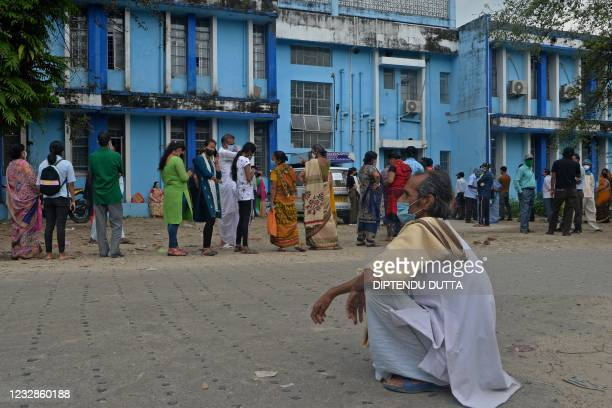 People queue up to get themselves inoculated with the Covid-19 coronavirus vaccine at the North Bengal Medical College and Hospital on the outskirts...