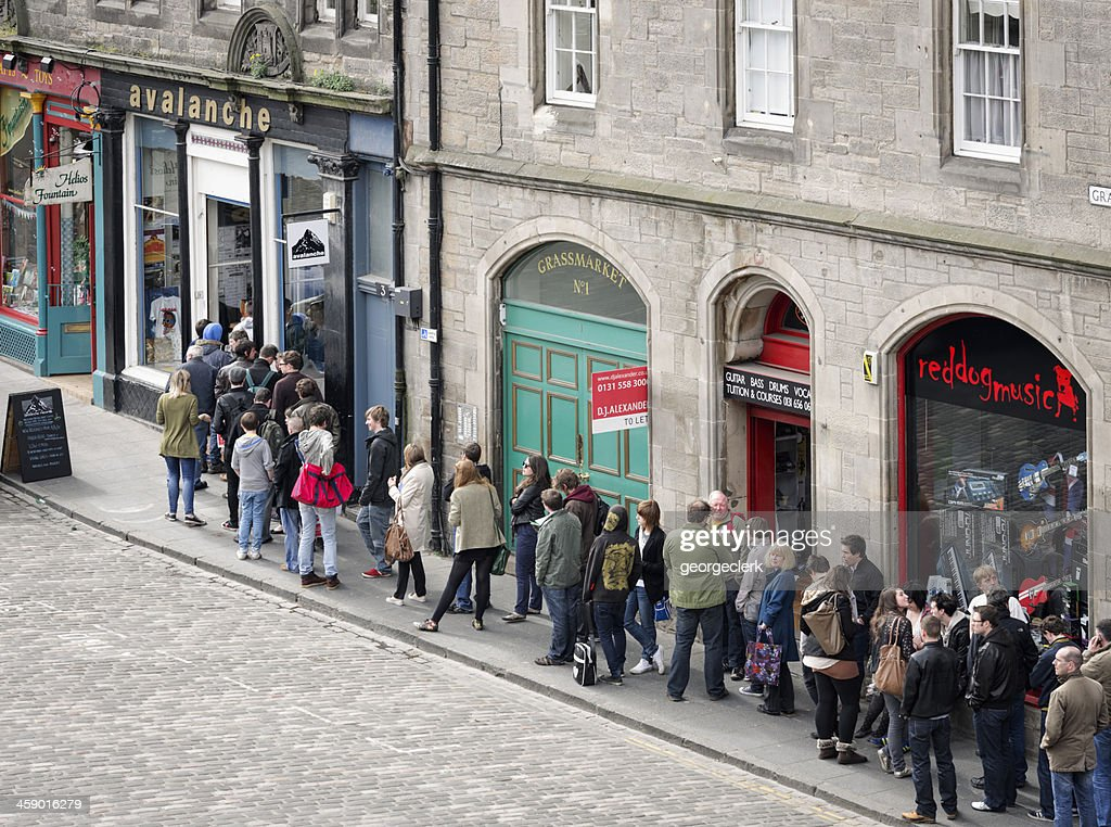 People Queueing Outside Avalanche Records : Stock Photo