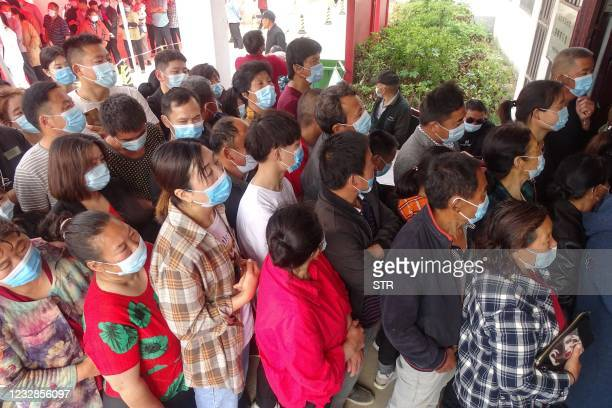 People queues to receive the Anhui Zhifei Longcom Covid-19 coronavirus vaccine in Linquan county, Fuyang city, in China's eastern Anhui province on...