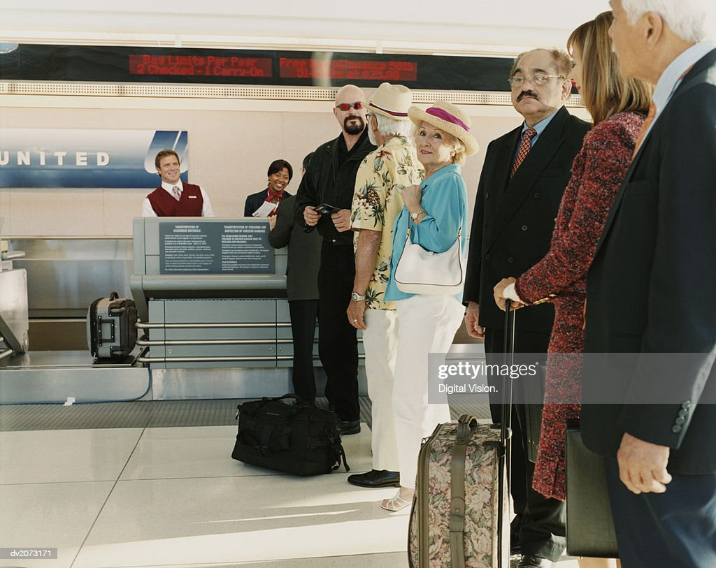 People Queuing at Airport Check In : Stock Photo