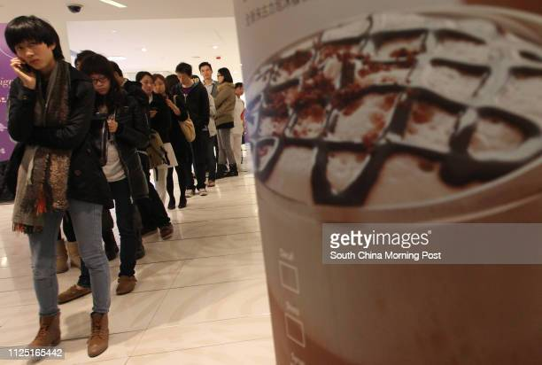 People queuing in Starbucks at WTC mall in Causeway Bay to participate in a fundraising event in which Starbucks Hong Kong will donate all beverage...