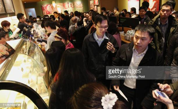 People queuing in Starbucks in Wan Chai to participate in a fundraising event in which Starbucks Hong Kong will donate all beverage sales proceeds to...