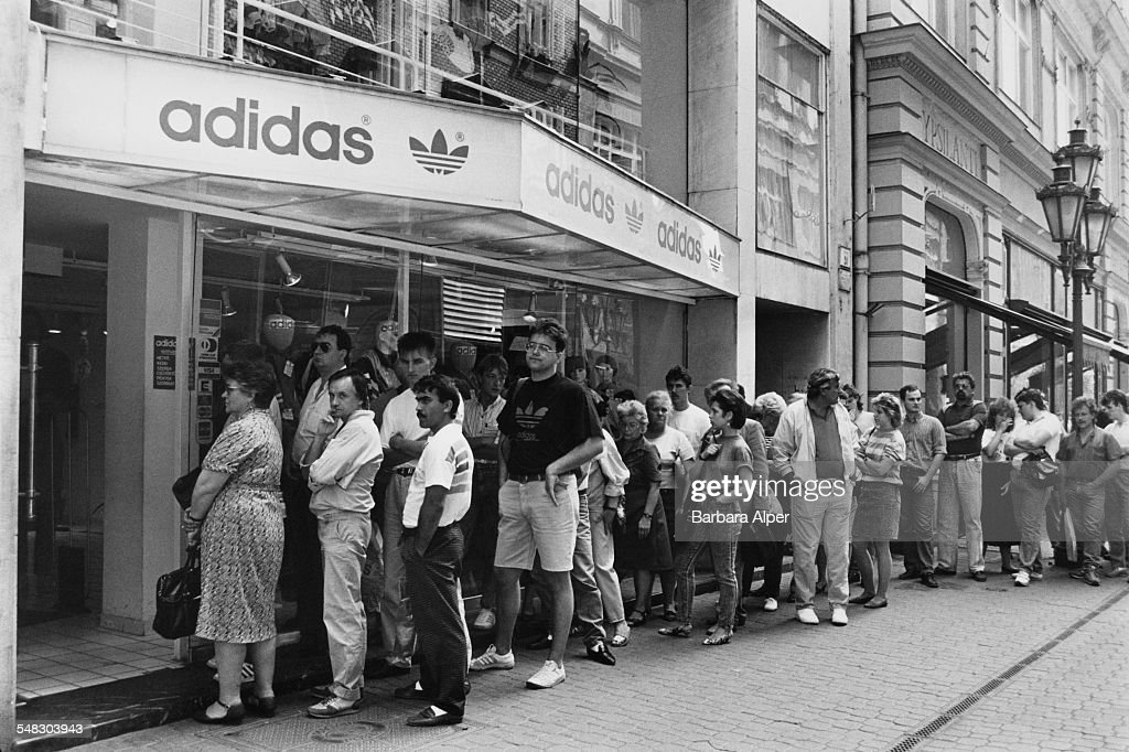 People queuing outside a shop selling Adidas shoes on Váci Utca in Budapest  Hungary 22nd May
