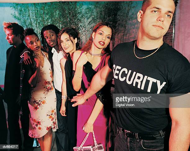 people queuing to get into a nightclub - bouncer security staff stock photos and pictures