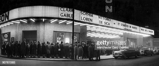 People queuing to see an evening showing of Vittorio De Sica's film 'It Started in Naples' starring Clark Gable and Sophia Loren