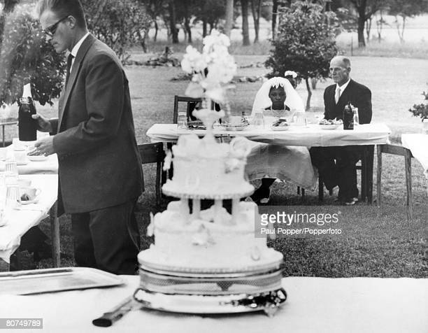 May 1963 White Rhodesian farmer Stuart FullerSandys with his black African bride Margaret Dube at their wedding near Salisbury which was poorly...