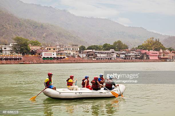 People rafting in Ganges River, Rishikesh, Uttarakhand, India.