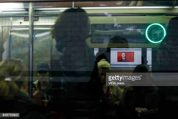 People raid the train while images of David Bowie are displayed as art installations on April 20 2018 in New York NY A Bowie exhibition inside...