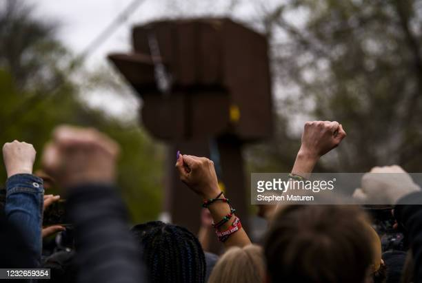 People raise their fists at a memorial for Daunte Wright on May 2, 2021 in Brooklyn Center, Minnesota. Twenty-year-old Wright was shot and killed...