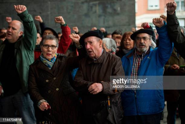 People raise their fists during demonstration in the village of Miraballes on May 18, 2019 calling for the release of one of the most influential...