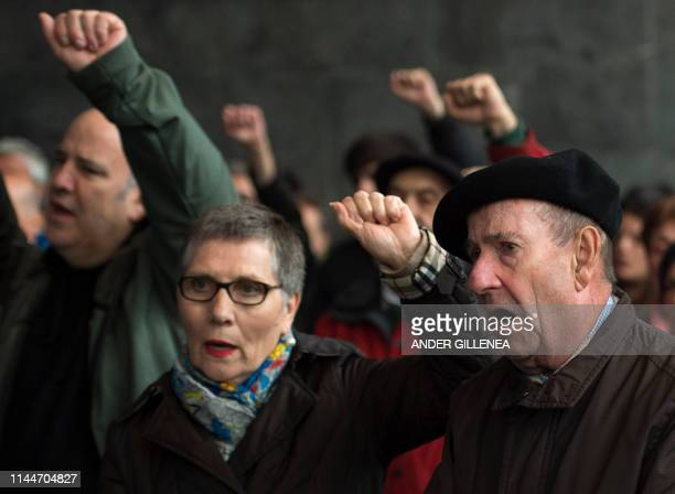 People raise their fists during demonstration in the village of Miraballes on May 18 2019 calling for the release of one of the most influential...