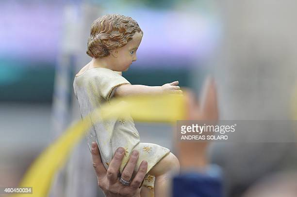 People raise their nativity figures in direction of pope Francis for the traditional blessing and the Sunday Angelus prayer at St Peter's square on...