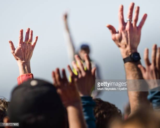people raising hands in event - march stock-fotos und bilder