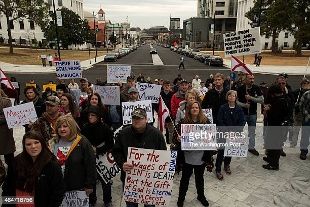 People rally against same sex marriage on the steps of the capitol in Montgomery AL on February 21 2015 The Alabama capitol was the destination of...