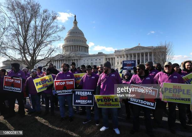 People rally against the partial federal government shutdown outside the U.S. Capitol January 10, 2019 in Washington, DC. A stalemate continues...
