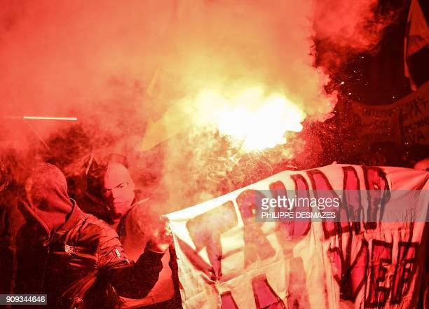 People rally as they protest against the attendance of the US president to the upcoming Davos World Economic Forum on January 23 in central Zurich /...