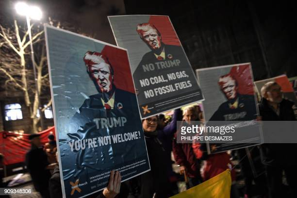 TOPSHOT People rally as they protest against the attendance of the US president to the upcoming Davos World Economic Forum on January 23 in central...