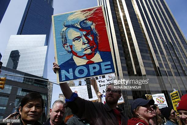 TOPSHOT People rally as they take part in a protest against Republican presidential frontrunner Donald Trump in New York on March 192016 / AFP / KENA...
