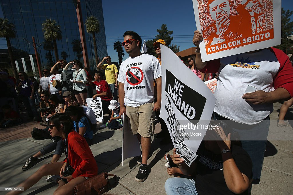 People rally at an immigration reform demonstration outside the U.S. Immigration and Customs Enforcement (ICE), office on March 11, 2013 in Phoenix, Arizona. The march called for an end to deportation, family separation and workplace raids on immigrants.