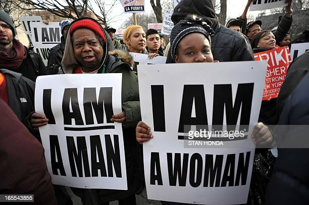 People rally at Marcus Garvey Park in Harlem during a protest by fast food workers and supporters for higher wages April 4 2013 in New York The...