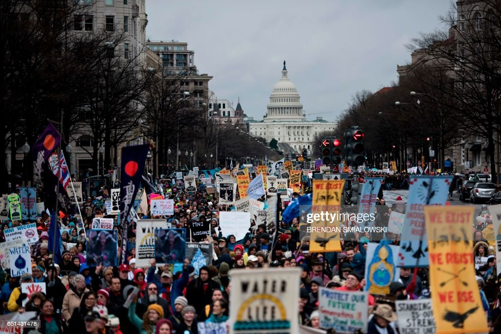TOPSHOT - People rally during the Native Nations Rise protest on March 10, 2017 in Washington, DC. Native tribes from around the US gathered for four days of protest against the administration of US President Donald Trump and the Dakota Access oil pipeline. / AFP PHOTO / Brendan Smialowski