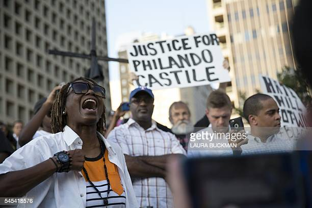 People rally in Dallas Texas on July 7 2016 to protest the deaths of Alton Sterling and Philando Castile Black motorist Philando Castile a school...