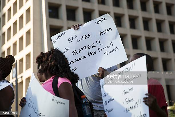 People rally in Dallas Texas on July 7 2016 to protest the deaths of Alton Sterling and Philando Castile Black motorist Philando Castile a school...
