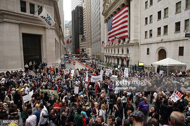 People rally in front of the New York Stock Exchange in the financial district against the proposed government buyout of financial firms September 25...