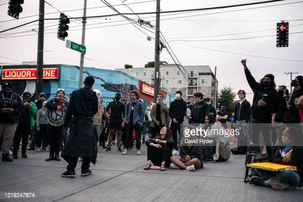 "People rally in front of the Seattle Police Departments East Precinct in the so-called ""Capitol Hill Autonomous Zone"" on June 10, 2020 in Seattle,..."
