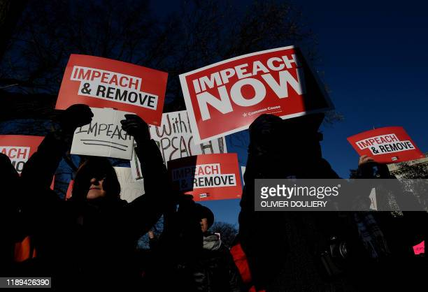 People rally in support of the impeachment of US President Donald Trump in front of the US Capitol as the House readies for a historic vote on...
