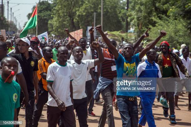 People rally in the Burkinabe capital Ouagadougou on September 29 2018 during the first large protest by supporters of the opposition against the...