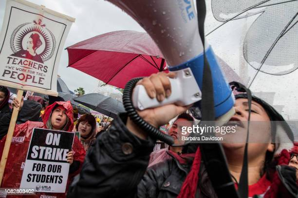 People rally in the streets of downtown in the pouring rain during a United Teachers Los Angeles strike on January 14 2019 in Los Angeles California...