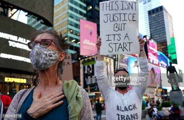 People rally in Times Square in New York City April 20, 2021 after Derek Chauvin was found guilty on all counts in the murder of George Floyd. -...