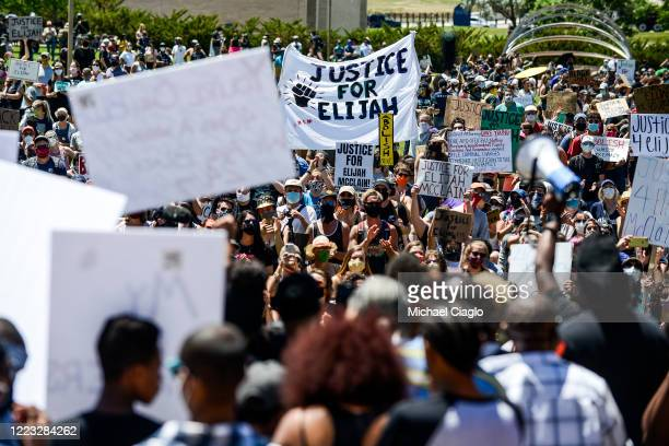 People rally outside the Aurora Police Department Headquarters to demand justice for Elijah McClain on June 27 2020 in Aurora Colorado On August 24...
