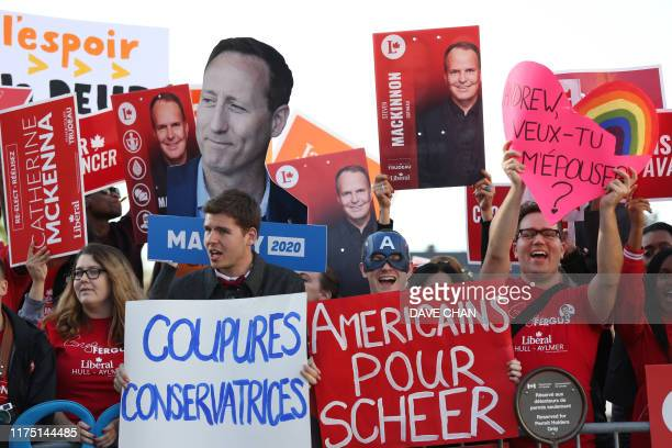 People rally outside The Leaders Debate at the Canadian Museum of History in Gatineau Quebec on October 10 2019 Prime Minister Justin Trudeau's...