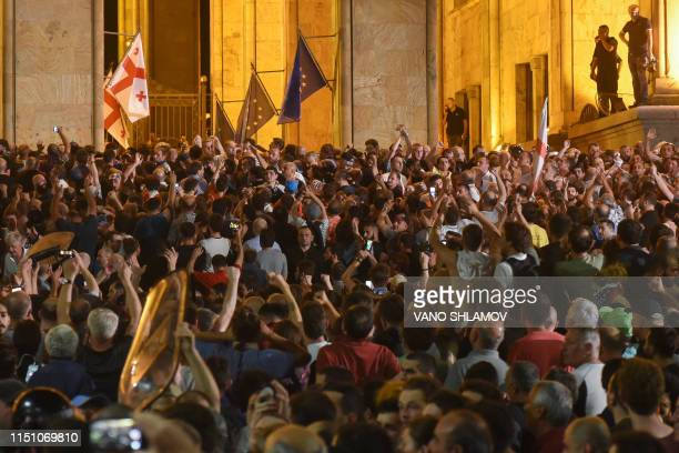 People rally outside the parliament in Tbilisi on June 20 2019 Georgian police used tear gas to disperse thousands of protesters attempting to storm...