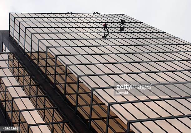people rapelling down an vancouver waterfront center, canada - stunt person stock photos and pictures