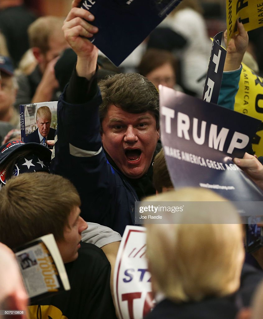 People reach out to greet Republican presidential candidate Donald Trump during a campaign event at the University of Iowa on January 26, 2016 in Iowa City, Iowa. Trump continues his quest to become the Republican presidential nominee.