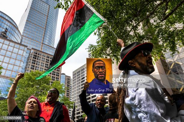 People react after learning the sentencing of former Minneapolis Police officer Derek Chauvin outside the Hennepin County Government Center on June...