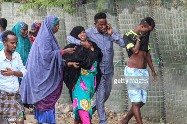 People react after the explosion by a suicide bomber next to a police academy in Mogadishu Somalia on November 17 2020 Five people some of them...
