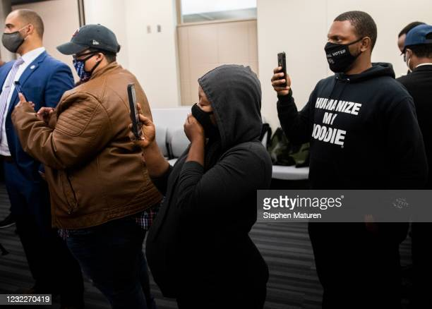 People react after viewing the body camera footage of the killing of 20-year-old Daunte Wright after it was played during a press conference at the...