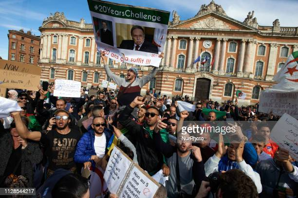 People react Algerians in Toulouse gathered on the main square of Toulouse the Capitole to protest against the reelection bid of Algerian President...