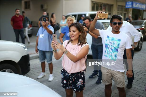 People react and take pictures as US Pastor Andrew Craig Brunson arrives at his house on July 25 2018 in Izmir Turkey on July 15 2018 moved from jail...