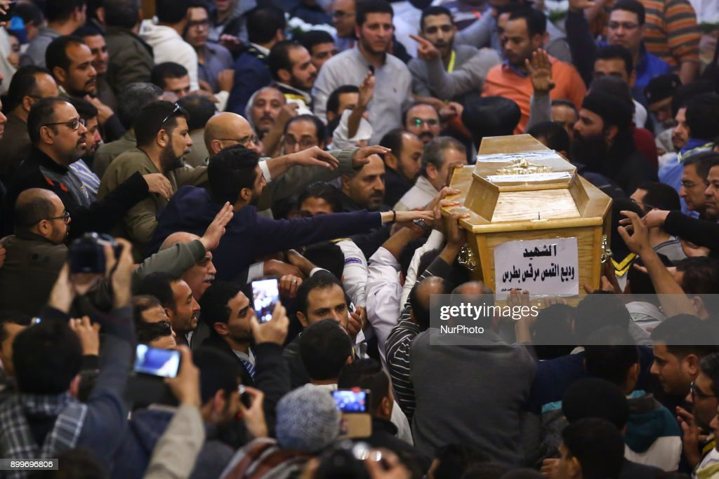 People react around a casket of a female victim during the funeral of victims of an attack, at a church in the working-class suburb of Helwan, Cairo, Egypt, 29 December 2017. At least ten people were killed Friday when a terrorist attack on the Marminna church was foiled in Helwan, south of Cairo.
